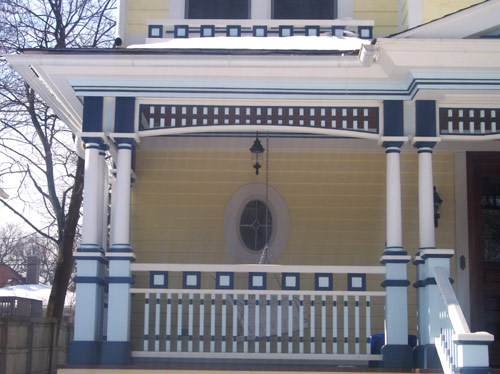 Porch with columns and railings