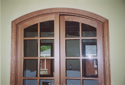 Arched French Doors With Oak Casing